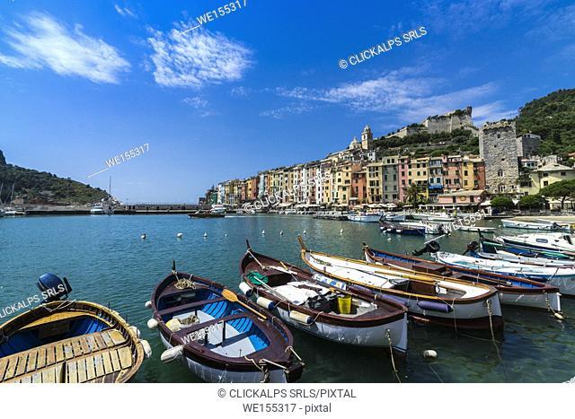 Boats in the blue sea frame the typical colored houses of Portovenere La Spezia province Liguria Italy Europe