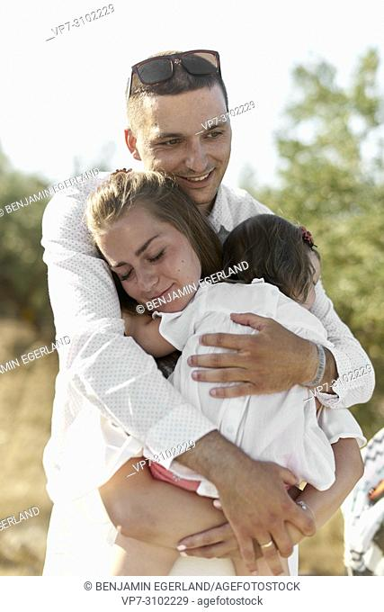 parents with one child, enjoying togetherness, outdoors in nature. Sensible, bonding, love
