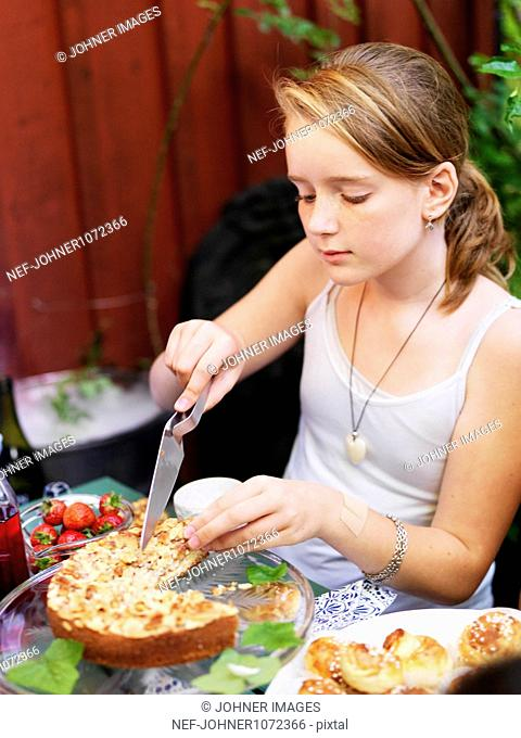 Girl cutting cake