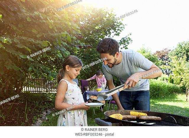 Family having a barbecue in garden