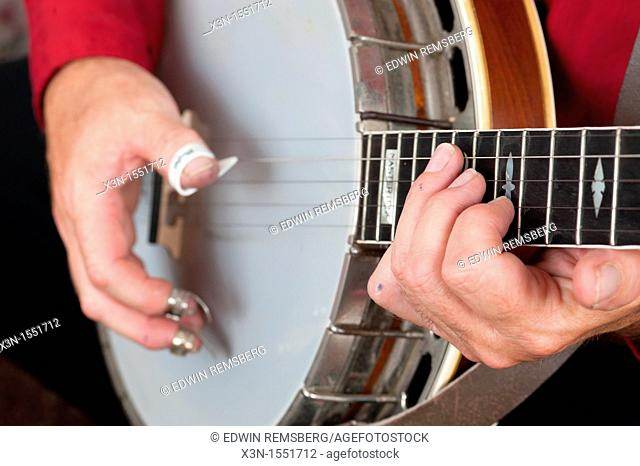Dave Reed playing the banjo with clawhammer picks