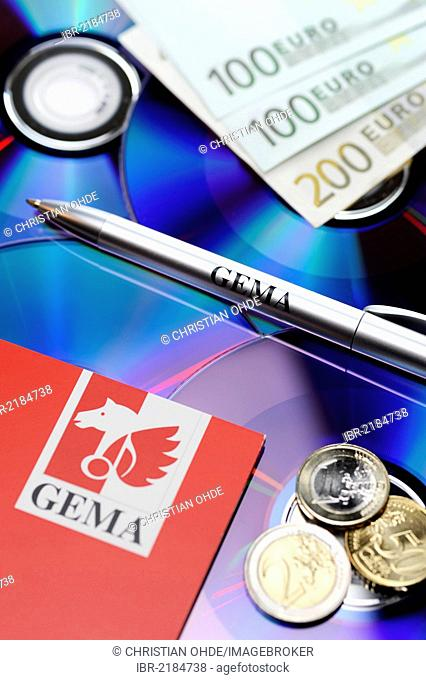 CDs, banknotes and a pen labelled GEMA, symbolic image for GEMA fees