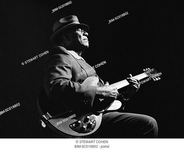 African American man playing guitar