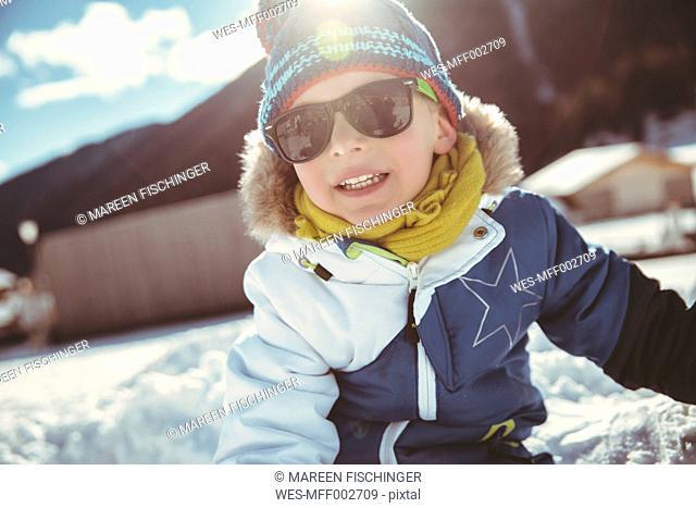Italy, Val Venosta, Slingia, boy with sunglasses in snow