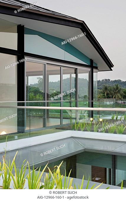 Glass walls and doors on shallow roofed modern home