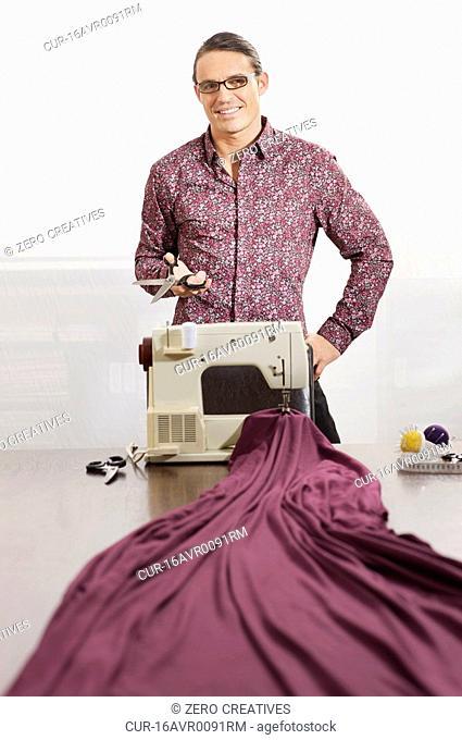 tailor enjoying his job