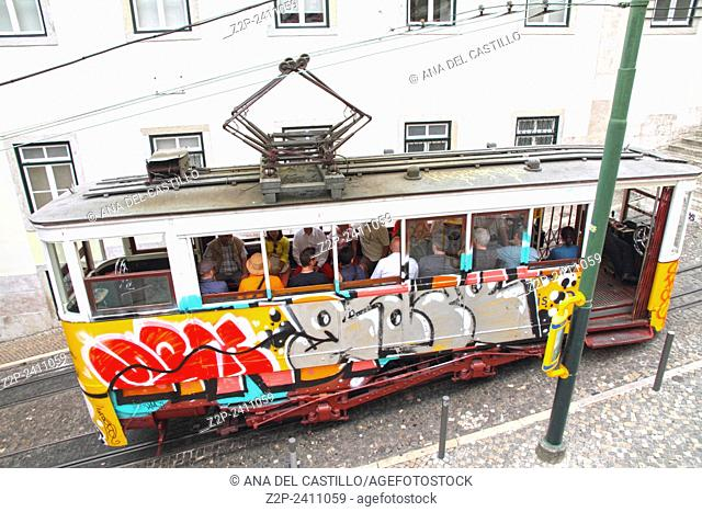 Typical tram with tourists. Lisbon Portugal