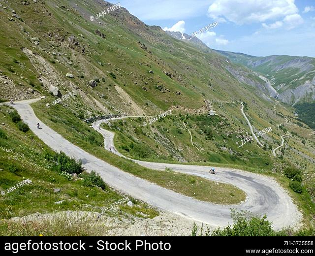 cyclists at winding road in Vallee du Ferrand and Alpe du Huez in France