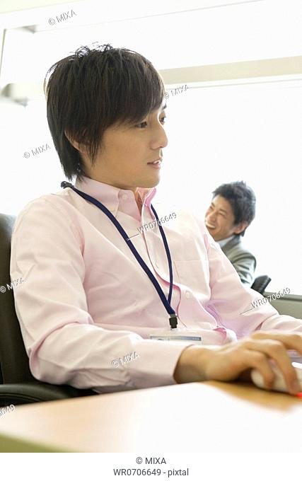Two businessmen working at office