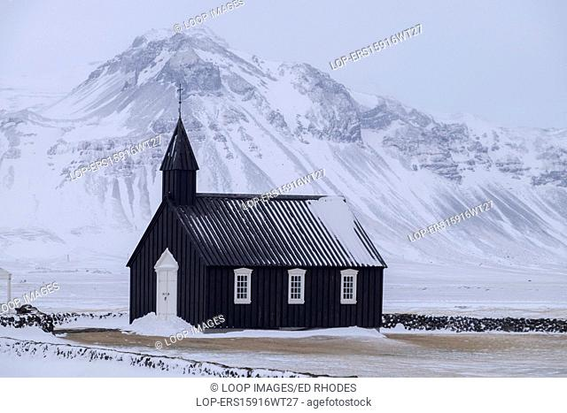 Budir Black church in winter backed by the Snaefellsnes mountains