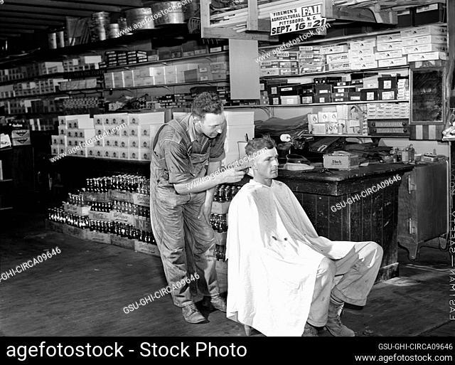 Free haircut on Saturday morning in W.M. Scott's general store. Farrington, Chatham County, North Carolina, USA, Marion Post Wolcott, U.S