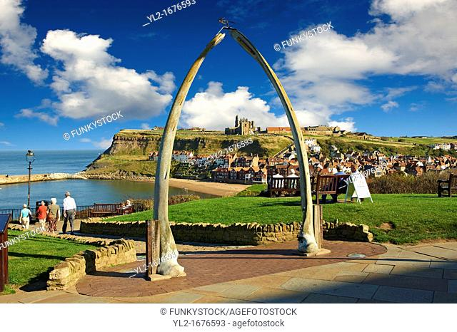 Whale Bone arch overlooking Whitby harbour with Whitby Abbey on the headland  Whitby, North Yorkshire, England