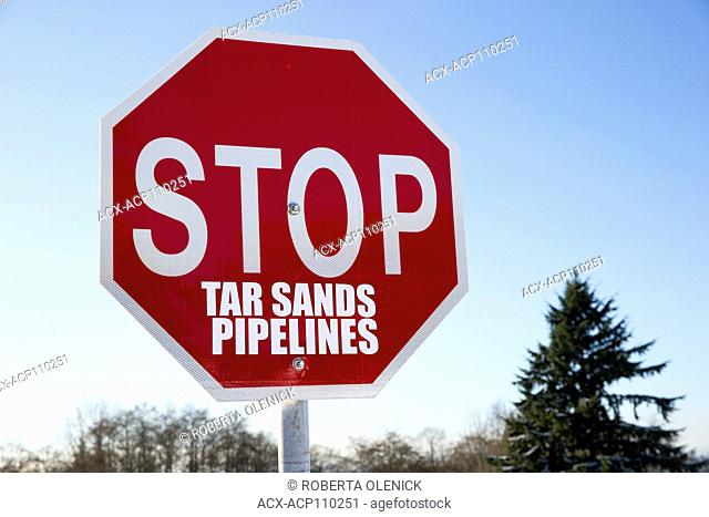 STOP sign modified to protest Kinder Morgan's proposed pipeline expansion project, Burnaby Mountain, British Columbia