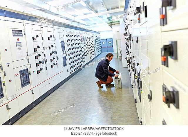 Technician by electrical panels at maintenance area, Hospital Donostia, San Sebastian, Basque Country, Spain