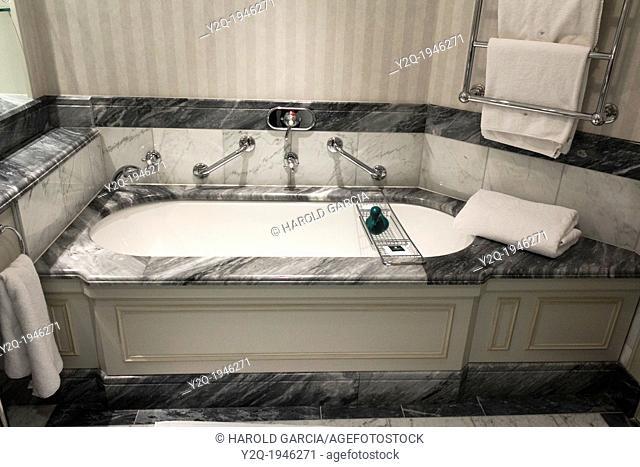 Interior design of a bathroom with a bathtub