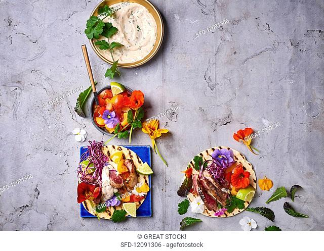 Flatbreads with tuna, herbs, edible flowers and a dip