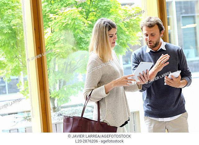 Pair of students with digital tablet, University, Donostia, San Sebastian, Basque Country, Spain