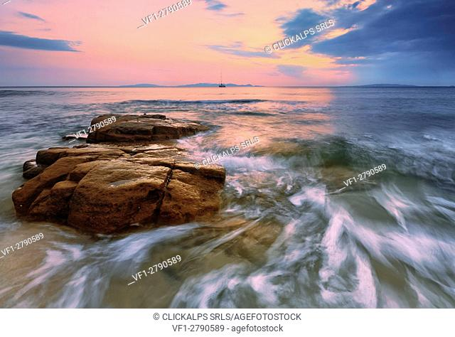 Italy, Tuscany, Grosseto District, Scarlino - Summer sunset at Cala Violina