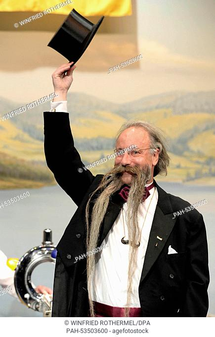 Juergen Burkhardt waves to the audience during the European Beard Championship in Schluchsee, Germany, 08 November 2014. Burkhardt and his 92cm beard are...