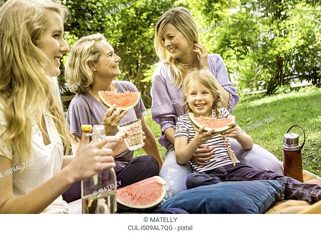 Three generation of women having picnic