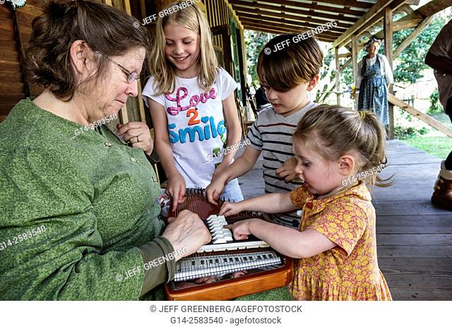 Florida, Gainesville, Dudley Farm State Park, Homestead and Living History Museum, property, volunteer, reenactor, woman, teaching, dulcimer, how play, girl