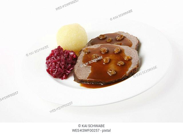 Rhenish marinated beef, dumpling and red cabbage, close-up