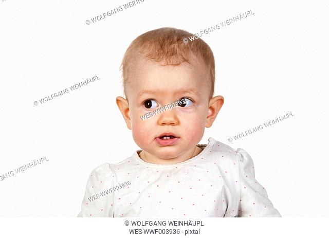 Portrait of baby girl in front of white background