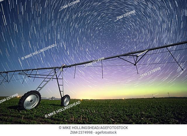 Auroras dance with the Milky Way above an Iowa farm field