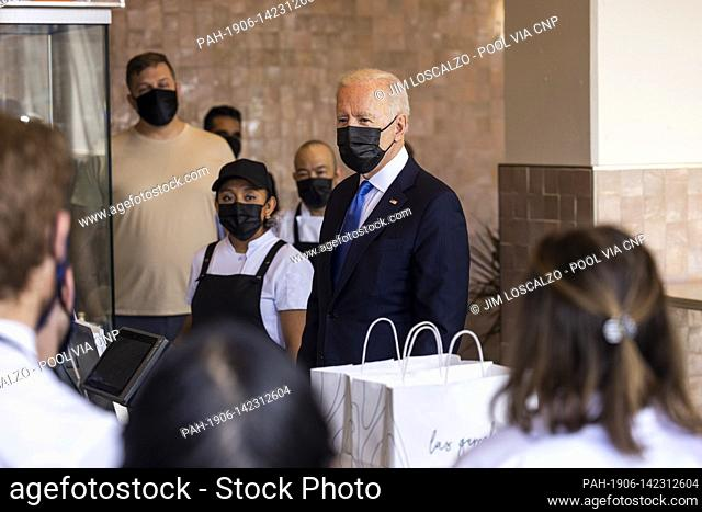 United States President Joe Biden speaks to workers as he picks up tacos during a visit to Las Gemelas Restaurant in Washington, DC, USA, 05 May 2021