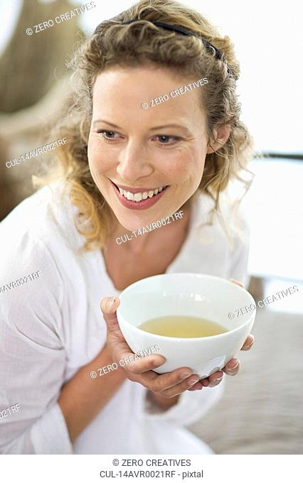 middle-aged woman drinking tea