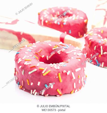 cakes glazed with colored sugar granules