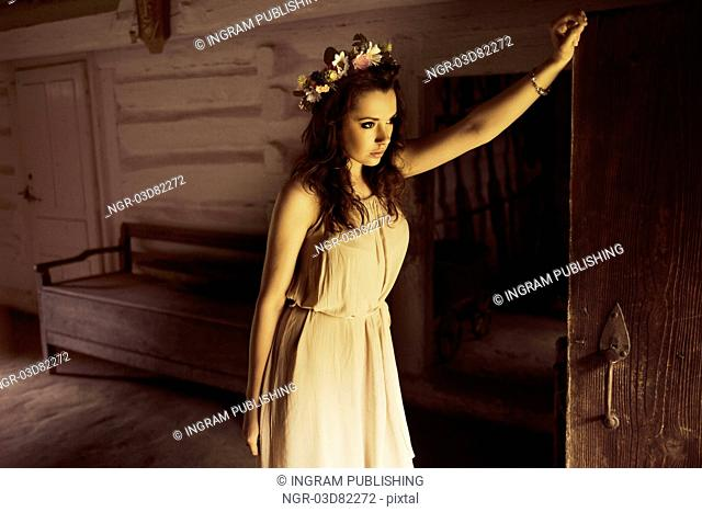 Flower princess in the old wooden house