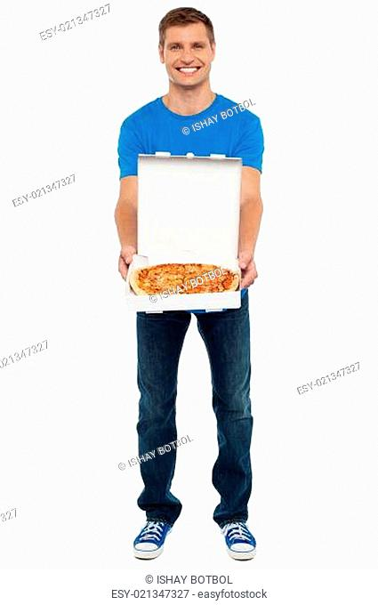 Casual guy showing freshly baked yummy pizza