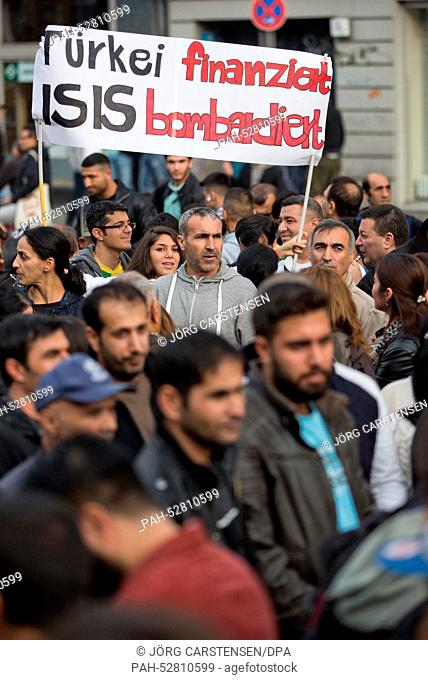 Protest participants hold up a banner saying 'Tuerkei finanziert ISIS bombardiert'(engl.'Turkey finances, ISIS bombs') prompting the German Federal Government...