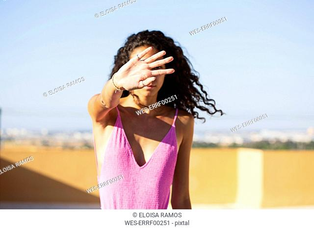 Portrait of teenage girl, obscured face