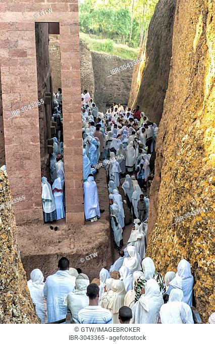 Pilgrims wearing a traditional white shawl attending a ceremony at the Bete Medhane Alem Church, UNESCO World Heritage Site, Lalibela, Amhara Region, Ethiopia