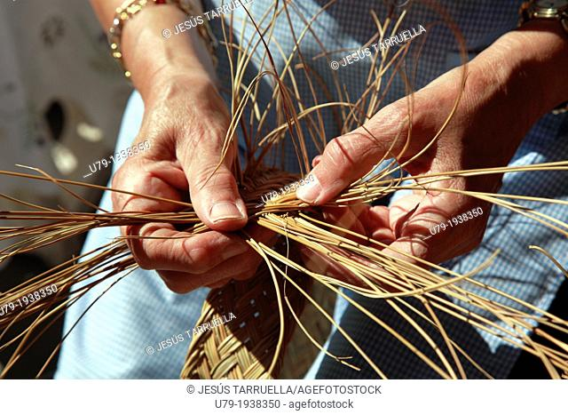 Woman hands with esparto weaving manually