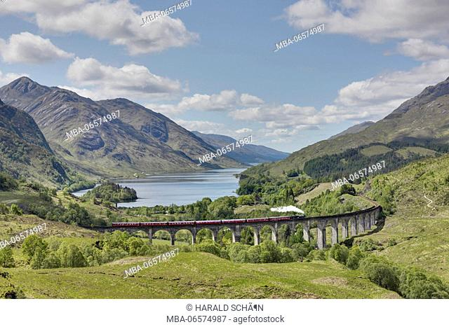 England, Scotland, Highlands, Glenvinnan, train crossing bridge, steam locomotive, lake, mountains, scattered clouds