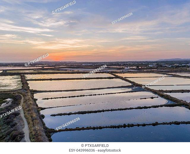 Sunset aerial seascape view of Olhao salt marsh Inlet, waterfront to Ria Formosa natural park. Algarve. Portugal