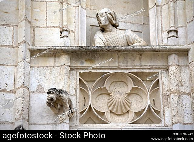 Statue (probably Jacques Coeur) on the balcony of a false window of the exterior facade of the Jacques Coeur's palace, Bourges, Cher department