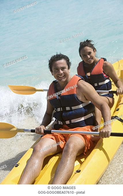 Couple kayaking in tropical waters