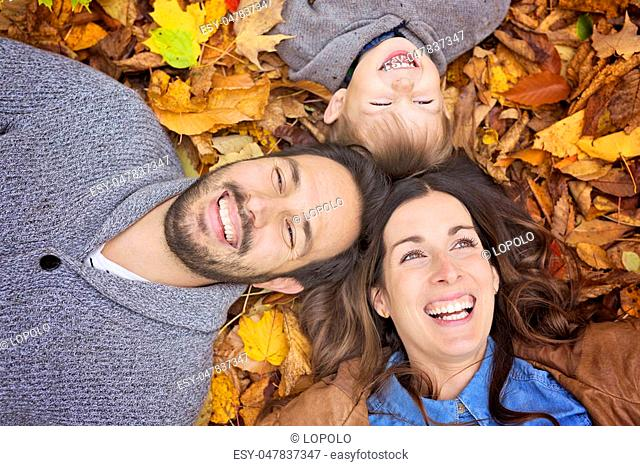 A Happy family relaxing outdoors In autumn park