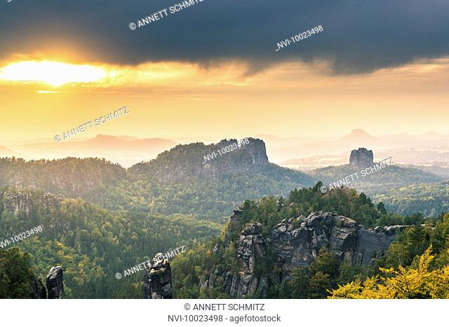 Schrammsteine rocks and Falkenstein at sunset, Elbe sandstone mountains, Saxony, Germany