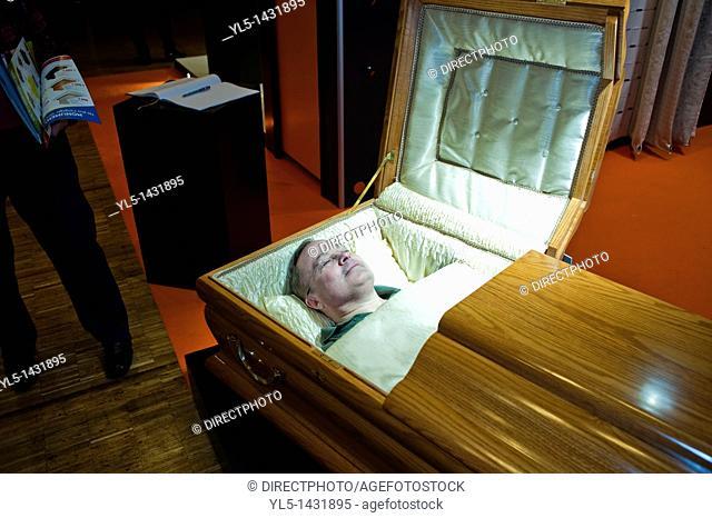 Paris, France, man Laying in Casket, at Death Trade Show, 'Salon de la Mort'