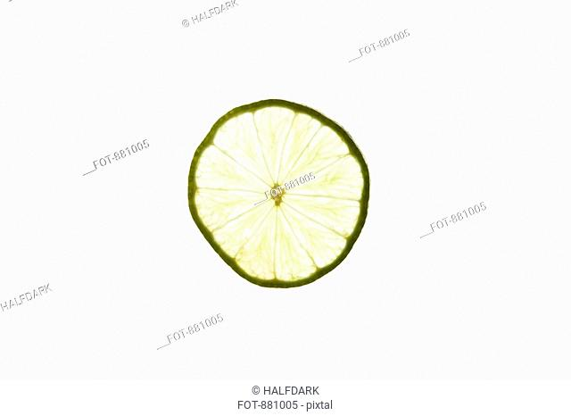 A slice of an organic lime on a lightbox