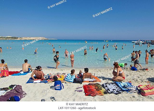 White sandy beach with many people, Nissi Beach near Ayia Napa northeast of Larnaca, Larnaca District, Cyprus