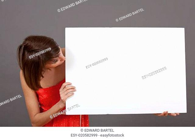 woman looking at white banner
