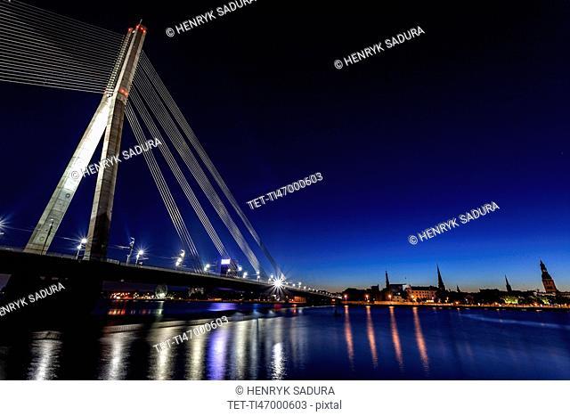 Illuminated Vansu Bridge reflecting in river