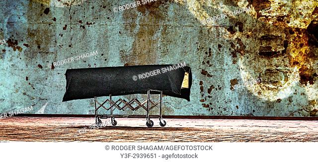 Coffin on a trolley. Waiting to go . .