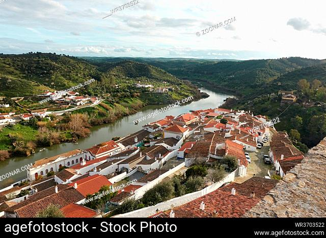 Mertola city view white historic beautiful traditional village in alentejo, Portugal with river guadiana and landscape